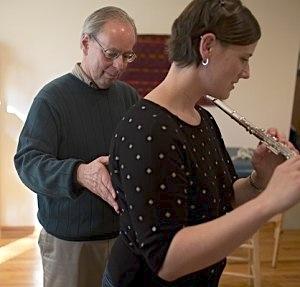 Alexander Technique teacher Robert Rickover works with a student